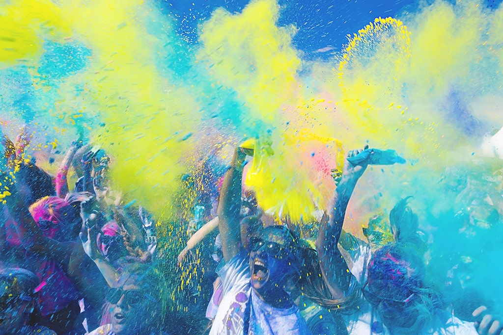 People spraying colour in the air